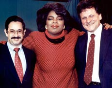 Oprah with Rick's client, Dr. C.P, Chambers